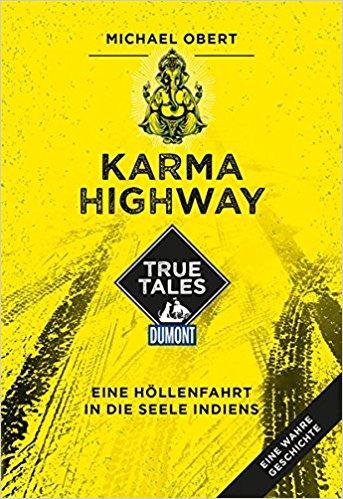 Das leuchtendgelbe Cover des Buchs Karma Highway zeigt kleine eine indische Gottheit und Reifenspuren.